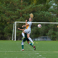 3rd year midfielder Nikita Senko (9) of the Regina Cougars  elevates for a header during the Women's Soccer Homeopener on September 10 at U of R Field. Credit: Arthur Ward/Arthur Images