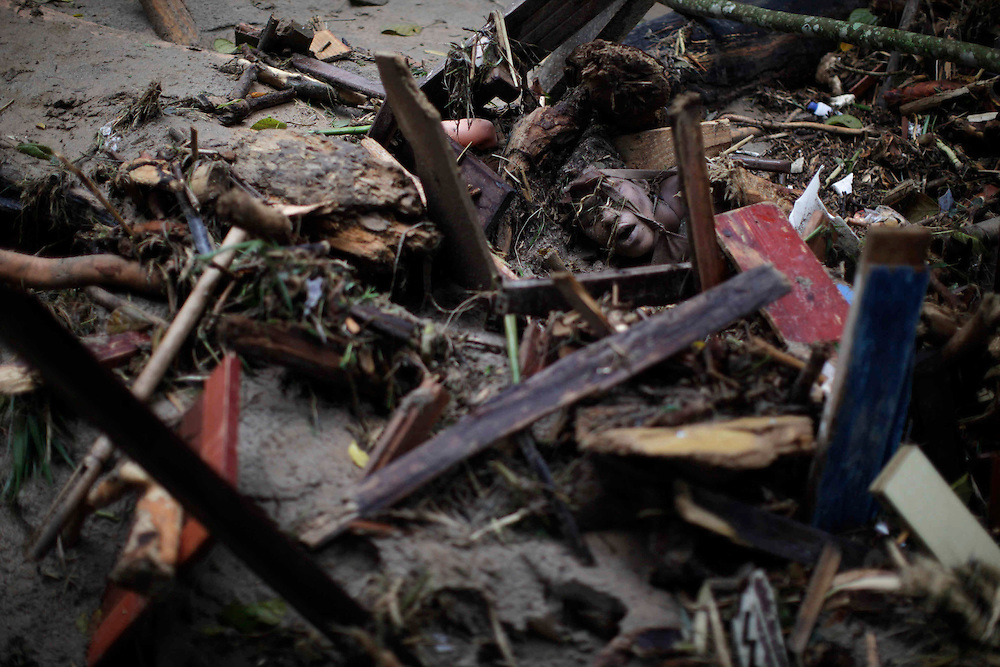 A landslide victim lies under debris in Teresopolis, Rio de Janeiro state, Brazil, Thursday Jan. 13, 2011.  At least 350 people have died after landslides hit early Wednesday, and 50 or more were still missing, according to officials.  <br /> <br /> A series of flash floods and mudslides struck several cities in Rio de Janeiro State, destroying houses, roads and more. More than 900 people are reported to have been killed and over 300 remain missing in this, Brazil&rsquo;s worst-ever natural disaster.