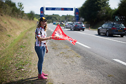 A young fan cheers the race on during the 121.5 km road race of the UCI Women's World Tour's 2016 Grand Prix Plouay women's road cycling race on August 27, 2016 in Plouay, France. (Photo by Balint Hamvas/Velofocus)