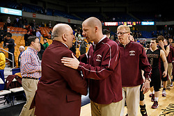 Wheeling Central Head Coach Mel Stephens is congratulated by Williamstown Head Coach Scott Sauro at the end of the game.