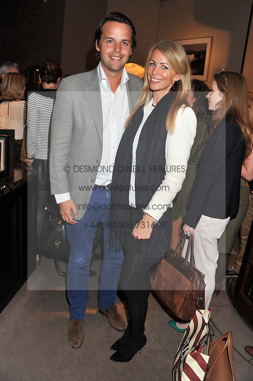 CHARLIE GILKES and ANNEKE VON TROTHA TAYLOR at the launch party for Spectator Life hosted by Andrew Neil at Asprey, 167 New Bond Street, London on 28th March 2012.