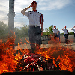 Kyle Green | The Roanoke Times<br /> May 22, 2009 - William Byrd ROTC Cadet Major, Robert Semones (middle), salutes a pile of burning United States flags during a Disposal of Unserviceable Flags ceremony held at William Byrd High School on Friday morning. The William Byrd ROTC burned 9 flags that were at the end of their life spans under an obligation to Title 4 of the Flag Code stating that :&quot;The flag, when it is in such condition that it is no longer a fitting emblem for display, should be destroyed in a dignified way, preferably by burning.&quot;