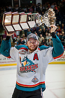 KELOWNA, CANADA - MAY 13: Rourke Chartier #14 of Kelowna Rockets skates with the Championship trophy on May 13, 2015 during game 4 of the WHL final series at Prospera Place in Kelowna, British Columbia, Canada.  (Photo by Marissa Baecker/Shoot the Breeze)  *** Local Caption *** Rourke Chartier;