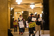 MADISON, WI – DECEMBER 19: Protestors circle the Wisconsin State Capitol rotunda on Monday, December 19, 2016 in advance of the Wisconsin presidential electors cast their ballots for Donald J. Trump.