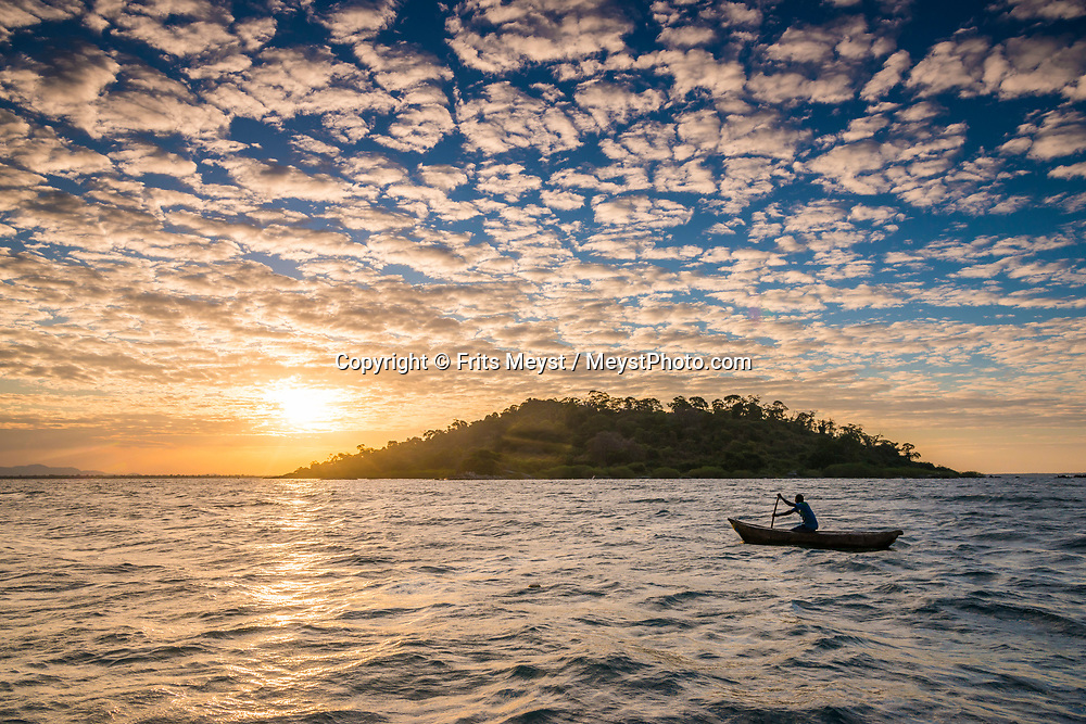 Malawi, July 2017. sunset on lake Malawi. Tucked away on Nankoma Island, a part of the Maleri Island archipelago, is the Blue Zebra Island Lodge. Under the protection of the Lake Malawi National Park, these three Islands offer a unique opportunity to see rare species of Malawi's colourful Cichlid fish that have earned this site its UNESCO World Heritage Site accreditation. The Islands are also renowned for their dazzling array of bird life. Malawi is known for its long rift valley and the third largest lake in Africa: Lake Malawi. Malawi is populated with friendly welcoming people, who gave it the name: the warm heart of Africa. In the south the lake make way for a landscape of valleys surrounded by spectacular mountain ranges. Photo by Frits Meyst / MeystPhoto.com