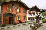 MITTENWALD, GERMANY - SEPTEMBER 01, 2010: Unidentified tourists visit traditional old painted housesi in Mittenwald, Germany.