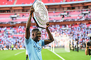 Manchester City Defender Benjamin Mendy (22) lifts the Community Shield as they beat Chelsea at the FA Community Shield match between Chelsea and Manchester City at Wembley Stadium, London, England on 5 August 2018. Picture by Stephen Wright.