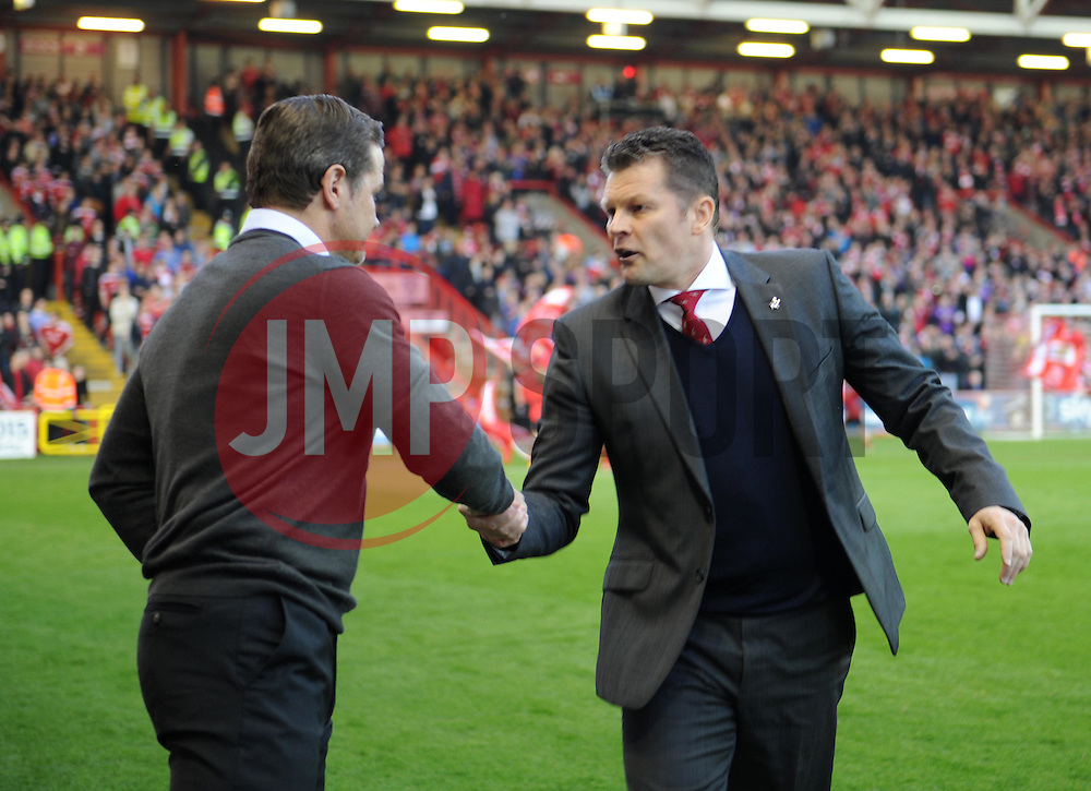 Bristol City manager Steve Cotterill shakes hands with Swindon Town Manager, Mark Cooper - Photo mandatory by-line: Paul Knight/JMP - Mobile: 07966 386802 - 07/04/2015 - SPORT - Football - Bristol - Ashton Gate Stadium - Bristol City v Swindon Town - Sky Bet League One