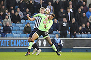 Millwall striker Steve Morison (20) and Bournemouth Defender Tyrone Mings (26) battling for the ball during the The FA Cup 3rd round match between Millwall and Bournemouth at The Den, London, England on 7 January 2017. Photo by Matthew Redman.