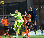 30th August 2019; Dens Park, Dundee, Scotland; Scottish Championship, Dundee Football Club versus Dundee United; Benjamin Siegrist of Dundee United punches clear from Jordon Forster of Dundee