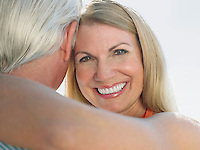 Woman embracing man portrait close up