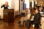 DACC president & CEO Phillip L. Parker (right) watches as Erin Hoeflinger, president of Anthem Blue Cross and Blue Shield (left) gives the keynote address during the Dayton Area Chamber of Commerce Breakfast Briefing at the Dayton Racquet Club in downtown Dayton, Friday, September 14, 2012.