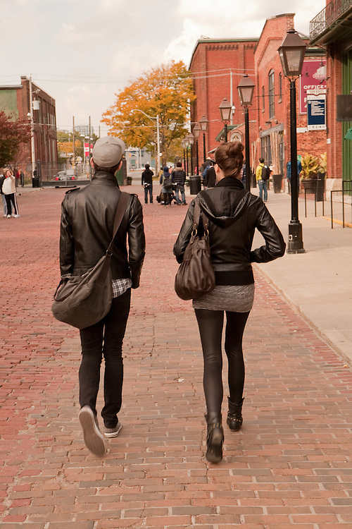 A couple stroll through Toronto's Distillery District