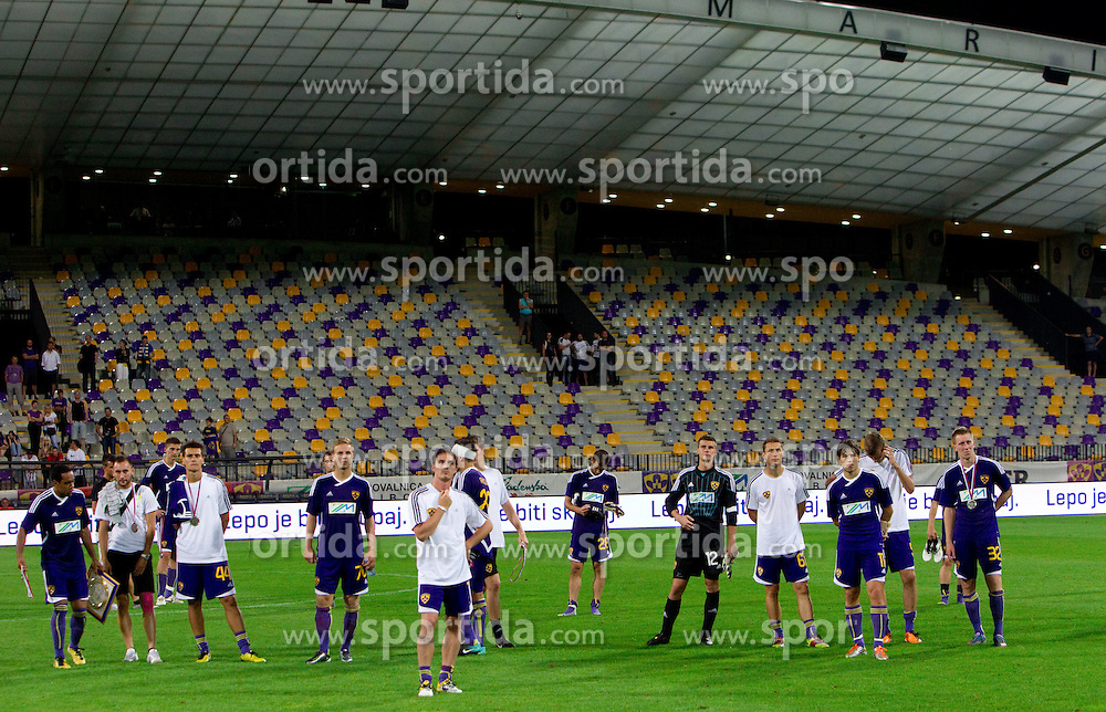 Players of Maribor disappointed during medal ceremony after the football match between NK Maribor and NK Domzale of Slovenian SuperCup 2011, on July 8, 2011, in  Stadium Ljudski vrt, Maribor, Slovenia. Domzale defeated Maribor 2-1 and became SuperCup Champion. (Photo by Vid Ponikvar / Sportida)