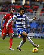 Reading defender, Michael Hector takes the ball under pressure and facing his own goal during the Sky Bet Championship match between Reading and Blackburn Rovers at the Madejski Stadium, Reading, England on 20 December 2015. Photo by Andy Walter.