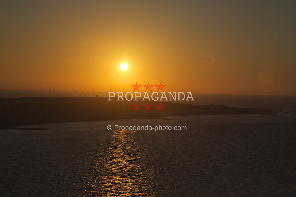 LIVERPOOL, ENGLAND - Saturday, June 21, 2014: Summer solstice sunset over the Wirral peninsula viewed from the 38th floor of the West Tower at a players' dinner during Day Three of the Liverpool Hope University International Tennis Tournament at the West Tower. (Pic by David Rawcliffe/Propaganda)