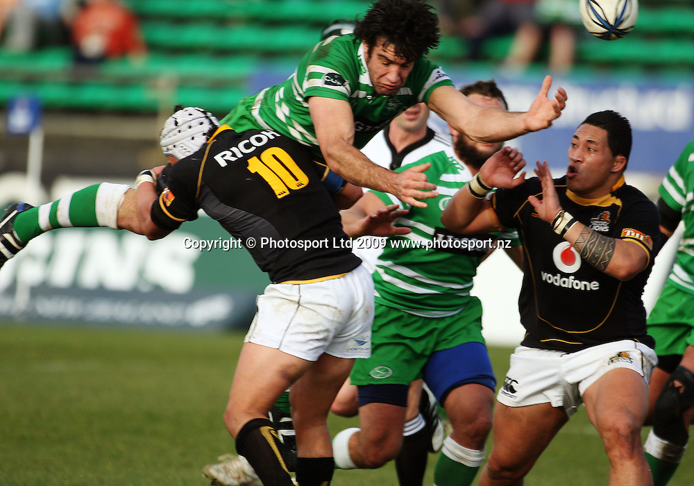 Manawatu captain Nick Crosswell loses the ball in the tackle of Dan Kirkpatrick as Anthony Perenise (right) looks on.<br /> Air NZ Cup preseason - Manawatu Turbos v Wellington Lions at FMG Stadium, Palmerston North, New Zealand, Friday 17 July 2009. Photo: Dave Lintott/PHOTOSPORT