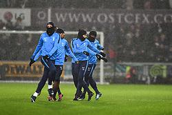 Tottenham Hotspur subs warm up in the rain - Mandatory by-line: Craig Thomas/JMP - 02/01/2018 - FOOTBALL - Liberty Stadium - Swansea, England - Swansea City v Tottenham Hotspur - Premier League