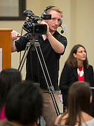 Houston ISD Multimedia intern Josh Ueckert works a camera during a press conference following a Broad Foundation research team tour Ortiz Middle School, May 29, 2013.