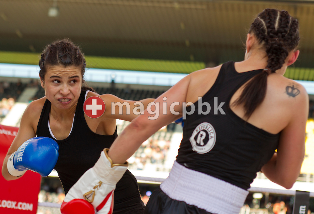 Aniya Seki of Switzerland (R) fights against Eva Marcu of Hungary during their Super Flyweight title fight at the Stade de Suisse Wankdorf in Bern, Switzerland, Saturday, July 7, 2012. (Photo by Patrick B. Kraemer / MAGICPBK)