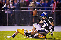 Coeur d'Alene High's Addison Johnson falls back on top of a Lewiston defender after catch and run into the end zone Friday during the first half of the Viking's 69-7 win over Lewiston.