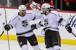 June 2; Newark, NJ, USA; Los Angeles Kings defenseman Drew Doughty (8) celebrates his goal with Los Angeles Kings left wing Dwight King (74) during the first period of the 2012 Stanley Cup Finals Game 2 at the Prudential Center.