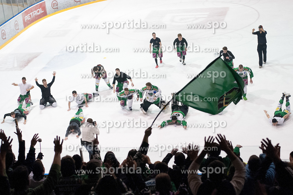 Player of HDD Tilia Olimpija celebrating after ice-hockey match between HK Acroni Jesenice and HDD Tilia Olimpija in fourth game of Final at Slovenian National League, on April 2, 2012 at Dvorana Podmezaklja, Jesenice, Slovenia. HDD Tilia Olimpija won 5:2 and become national champions in season 2011/12. (Photo By Matic Klansek Velej / Sportida.com)
