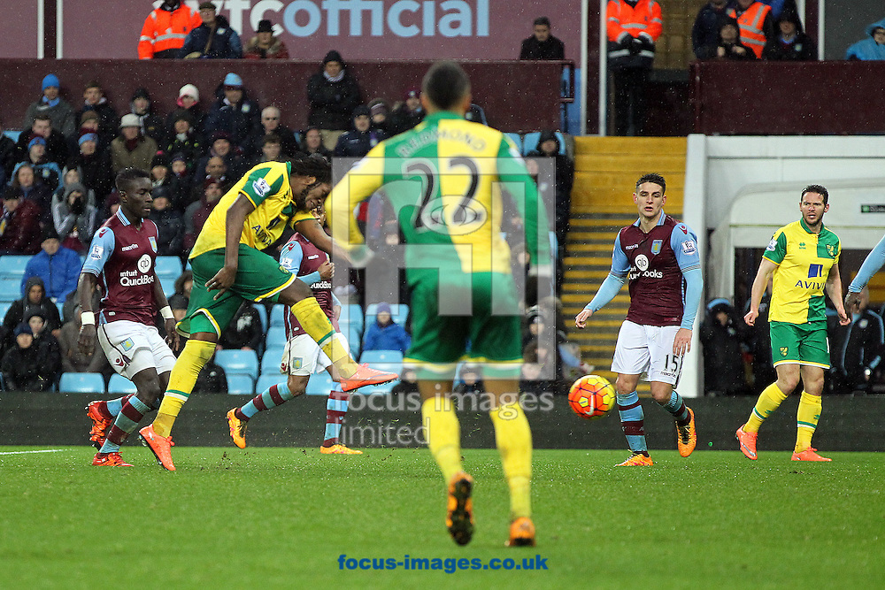 Dieumerci Mbokani of Norwich has a shot on goal during the Barclays Premier League match at Villa Park, Birmingham<br /> Picture by Paul Chesterton/Focus Images Ltd +44 7904 640267<br /> 06/02/2016