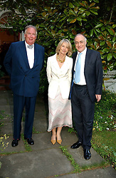 Left to right, LORD HESKETH,MICHAEL HOWARD and SANDRA HOWARD at a Conservative Party summer garden party hosted by Lord Hesketh and held at 7 Lansdowne Road, Notting Hill, London W11 on 28th June 2004.
