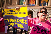 09 JANUARY 2012 - PHOENIX, AZ:  Cristy Cohn (CQ) demonstrates in support of pro-choice causes at the state legislature Monday. Gov Brewer delivered her State of the State inside while outside representatives of interest groups picketed and protested. There were more than 300 pro-choice demonstrators at the capitol and only about 50 pro-life demonstrators.    The Arizona legislature started its 2012 session and Gov. Jan Brewer delivered her State of the State Monday, Jan 9.                   PHOTO BY JACK KURTZ