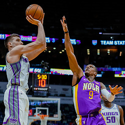 Jan 30, 2018; New Orleans, LA, USA; Sacramento Kings guard Bogdan Bogdanovic (8) shoots over New Orleans Pelicans guard Rajon Rondo (9) during the first quarter at the Smoothie King Center. Mandatory Credit: Derick E. Hingle-USA TODAY Sports