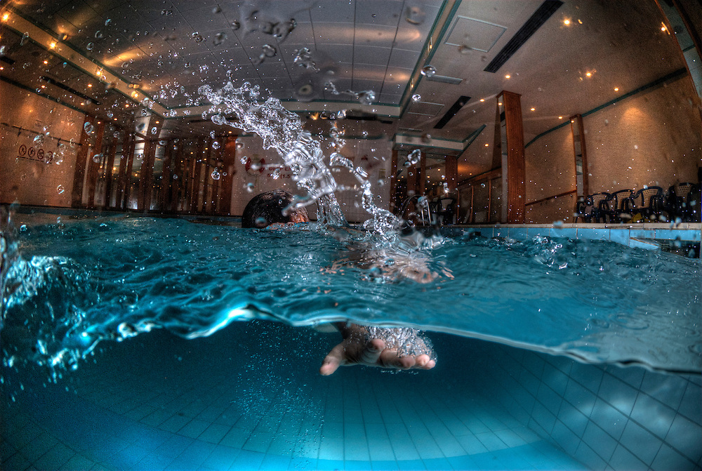 Over under shot of a young swimmer heading straight towards the camera.