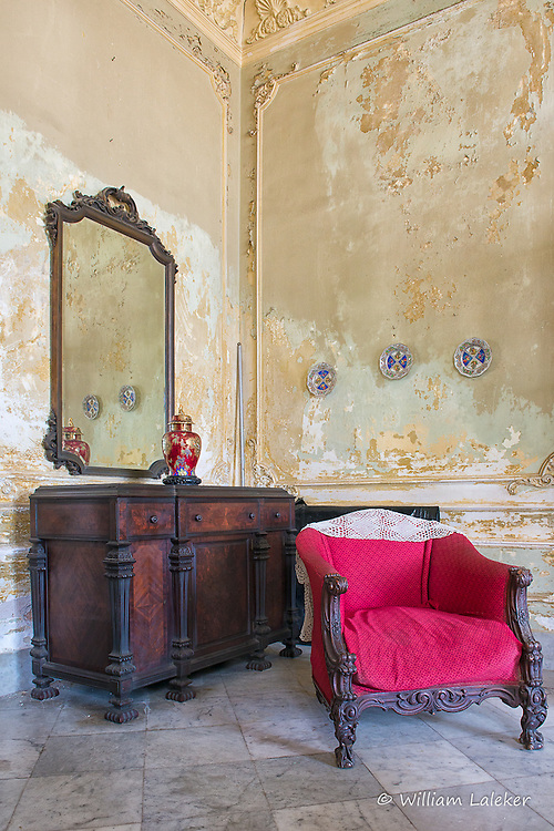 A parlor in a formally grand 1926 built home in the Vedado section of Havana Cuba.