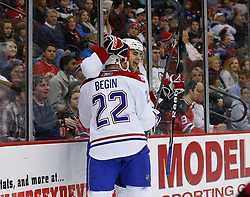 Jan 2, 2009; Newark, NJ, USA; Montreal Canadiens left wing Steve Begin (22) and Montreal Canadiens left wing Max Pacioretty (67) celebrate Pacioretty's first NHL goal during the first period at the Prudential Center.