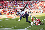 Houston Texans running back Akeem Hunt (33) slips through a tackle by San Francisco 49ers cornerback Kenneth Acker (20) at Levi's Stadium in Santa Clara, Calif., on August 14, 2016. (Stan Olszewski/Special to S.F. Examiner)