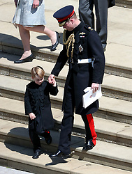 The Duke of Cambridge with Prince George leave St George's Chapel in Windsor Castle after the wedding.