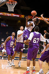 WF Damon Powell (Oakland, CA / McClymonds) grabs a rebound in traffic.  The NBA Player's Association held their annual Top 100 basketball camp at the John Paul Jones Arena on the Grounds of the University of Virginia in Charlottesville, VA on June 20, 2008