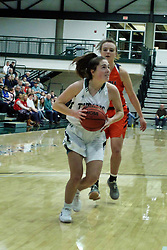 BLOOMINGTON, IL - December 15: Sam Munroe during a college women's basketball game between the IWU Titans  and the Carroll Pioneers on December 15 2018 at Shirk Center in Bloomington, IL. (Photo by Alan Look)