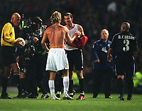Fotball<br /> Real Madrid Feature<br /> Foto: Colorsport/Digitalsport<br /> NORWAY ONLY<br /> <br /> David Beckham (Man Utd) exchanges shirts with Zinedine Zidane (Madrid) at the final whistle. Manchester United v Real Madrid. Champions League 1/4 final 2nd leg. 23/4/2003