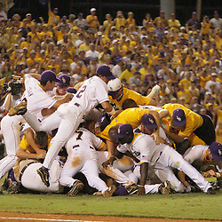 09 June 2008:  LSU players dog pile on the pitchers mound in celebration of the Tigers 21-7 victory over the UC Irvine Anteaters in game three of the NCAA Baseball Baton Rouge Super Regional Alex Box Stadium in Baton Rouge, LA. The win advances the LSU Tigers to the College Baseball World Series in Omaha, Nebraska..
