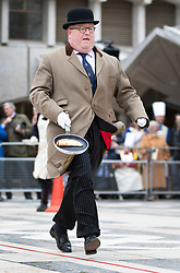 © Licensed to London News Pictures. 05/03/2019. London, UK. Poulterer Benjamin Browning tosses his pancake as he takes part in an inter-Livery Company pancake race in Guildhall Yard in The City of London. Participants from the Poulters, the Fruiterers, the Cutlers, Mansion House, Guildhall and Old Bailey are raising money for The Lord Mayor's Charity. Photo credit: Peter Macdiarmid/LNP