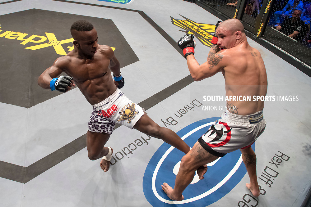 JOHANNESBURG, SOUTH AFRICA -NOVEMBER 04: (L-R) Bokang Masunyane and Magno Alves - Flyweight - in action during EFC 65 Fight Night at Carnival City on November 04, 2017 in Johannesburg, South Africa. (Photo by Anton Geyser/EFC Worldwide/Gallo Images)