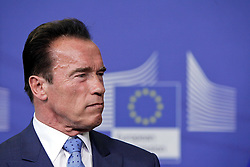 59895738<br /> U.S. actor and former Governor of California Arnold Schwarzenegger attends a press conference with European Commission President Jose Manuel Barroso (not seen) after their meeting at the European Union headquarters in Brussels, capital of Belgium, on June 24, 2013. They talked about climate change during their meeting on Monday  June 24, 2013. Picture by imago / i-Images<br /> UK ONLY