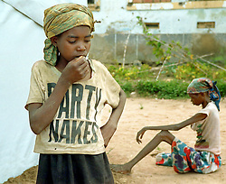 Angolans who are suffering from severe malnutrition wait to be treated in Kuito, Angola. Angola's brutal 26 year-civil war has displaced around two million people - about a sixth of the population - and 200 die each day according to United Nations estimates. .(Photo by Ami Vitale)