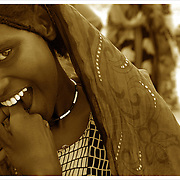 Ahadi Mohammed, 13, is shy but was willing to be photographed.  In order to make this picture the photographer befriended a young man who asked the Ahadi if the photographer could make the picture. She agreed. Djiboutian women are very shy and deferent to men in most cases. It is considered rude to look at women and speaking to them is also considered inappropriate. <br /> U.S. Military service members visited  Alaili Dadda, Ahadi's village of 300 near Obok, Djibouti to assess the difficulty of drilling a well here. The long term goal is to provide running water to a local clinic.  U.S. Navy Photo by Mass Communication Specialist 2nd Class Roger S. Duncan. (RELEASED)