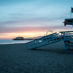 Santa Monica Pier and Lifeguard Tower 17 at sunset along the Pacific Ocean in Southern California. Copyright ⓒ 2017 Paul Velgos with All Rights Reserved.