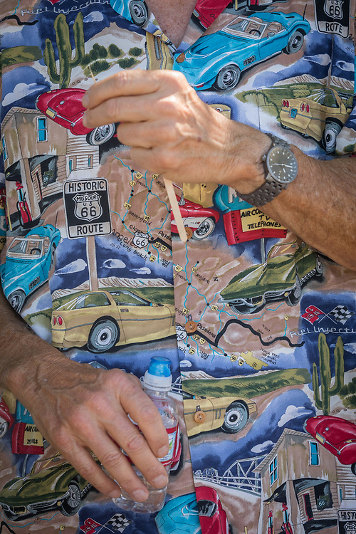 A man in automobile shirt attends the classic car show in Calistoga.