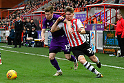 Harry Clifton (15) of Grimsby Town battles for possession with Alex Hartridge (34) of Exeter City during the EFL Sky Bet League 2 match between Exeter City and Grimsby Town FC at St James' Park, Exeter, England on 29 December 2018.