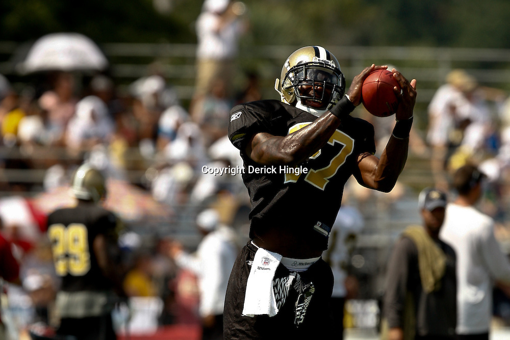 August 1, 2010; Metairie, LA, USA; New Orleans Saints cornerback Malcolm Jenkins (27) catches the ball during a training camp practice at the New Orleans Saints practice facility. Mandatory Credit: Derick E. Hingle