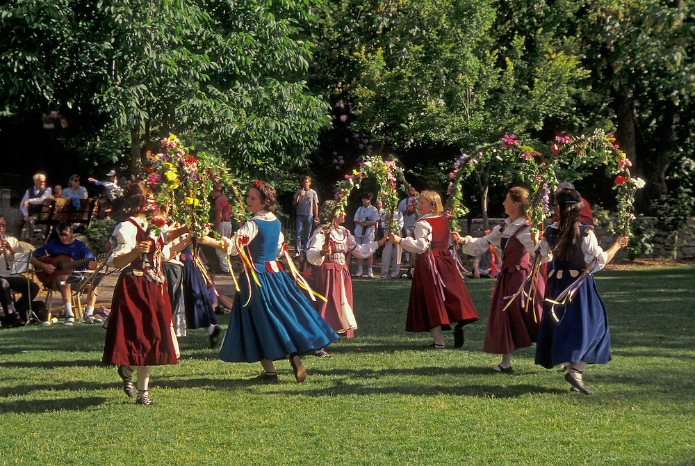 English Garland Dancing by the Briar Rose Ensemble in Lithia Park during the annual Feast of Will to celebrate opening of the Oregon Shakespeare Festival plays in the outdoor Elizabethan Theatre; Ashland, Oregon.